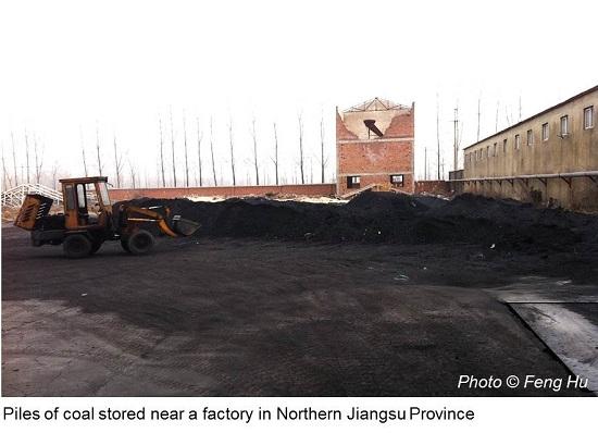 Piles of coal stored near a factory in Northern Jiangsu
